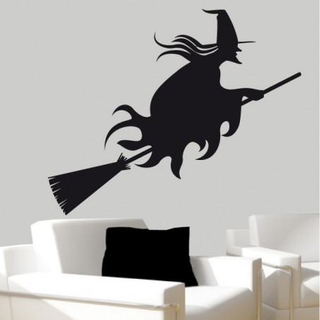 Sorcière sur son balai Halloween