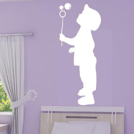 Silhouette Enfant qui souffle un bulle de savon